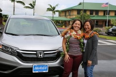 Kanoe Ho and Luci Higa in front of the new Honda CR-V presented to Kanoe from the Ryan Higa Foundation.